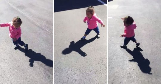 little-girl-gets-scared-by-her-own-shadow