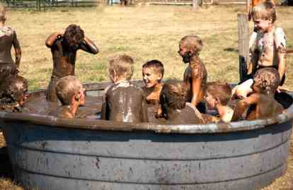 Mud-filled-tub-filled-with-boys