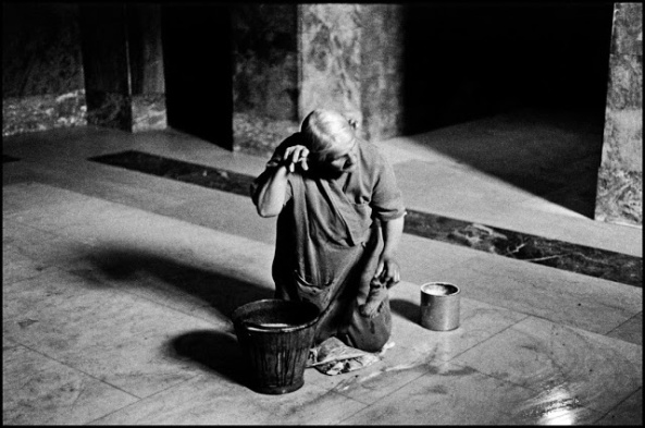UK. London. 1960. Woman washing floor.